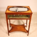 a fine bijouterie display table cabinet in mahogany with a stunning inlay